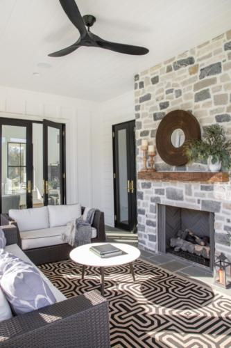 Mid-Century Farmhouse - Screen porch fireplace