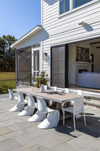 Mid-Century Farmhouse - Patio dining area with 16 ft double sliding door from Family Room